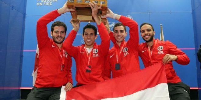 Egypt squash team holding trophy